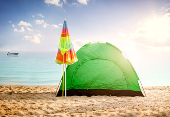beautiful background summer concept, tent on beach at sunset