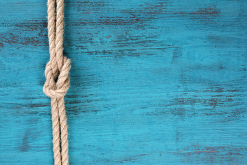 Marine knot on wooden background