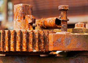 Old and rusty pinion gear of a machine in factory