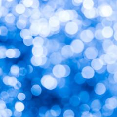 Light blue bokeh background.