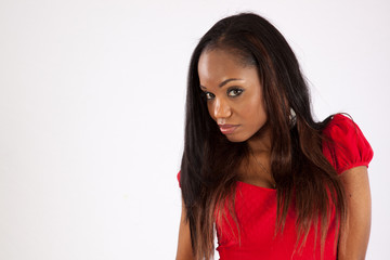 black woman in red blouse, looking serious