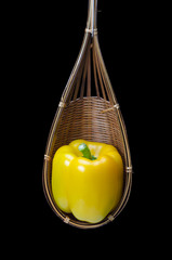 Still life with capsicum are placed in a wooden basket