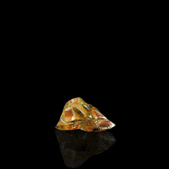 Shiny Amber Stone On Black Background First Version