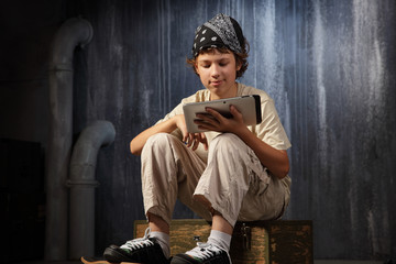 teenager sitting  with tablet pc