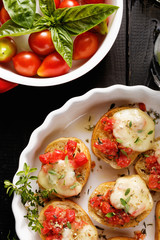 Tomato crostini with mozzarella, oregano and thyme