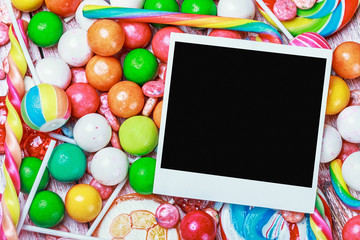 photo frame lies on sweets and candies