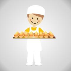 Panadero con bandeja de magdalenas