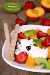 Fresh fruits salad with ice cream