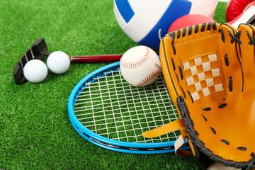Sports equipment on grass background