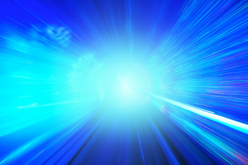 Tunnel of light - blue abstract background, movement at full spe