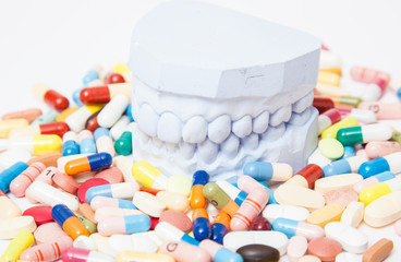 Plaster cast of teeth within various pharmaceuticals