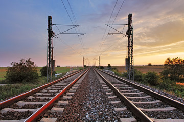 Fototapeten Eisenbahnschienen Railway at sunset