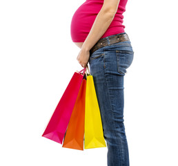 Pregnant woman shopping isolated on white