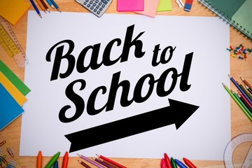 Composite image of back to school message with arrow