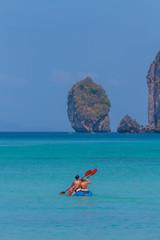 Tourist kayaking in the Thai ocean