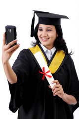 Young female graduated student taking selfie