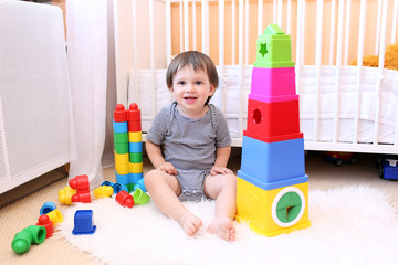 lovely baby playing toys