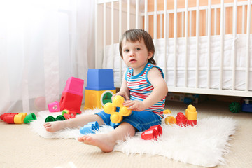 baby with toys at home