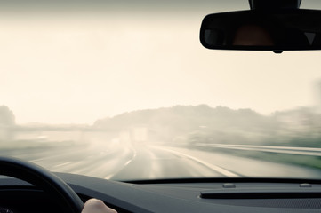 Driving on a Highway on a Rainy and Misty Day