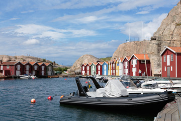 Boathouses at famous Smögen bridge in Bohuslän, Sweden.