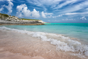 Tropical beach with  wave crashing on sand in the Bahamas