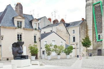 statue on Rue du Musee street in Anges, France