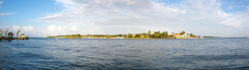 Colorful Caribbean buildings over the water with boats at dock