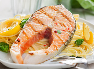 Gourmet grilled salmon steak on linguine pasta