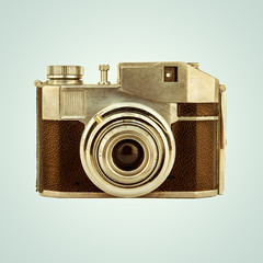 Retro styled image of a vintage photo camera