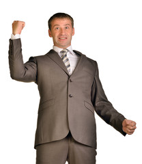 Joyful businessman raised his hands up