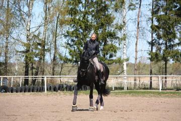 Woman riding black horse