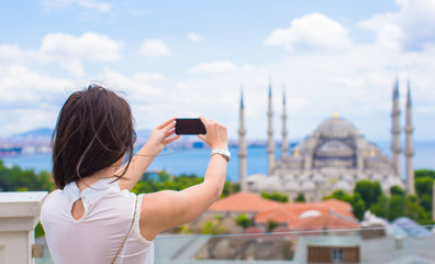 Young girl making a photo on cellphone at old town of Istanbul