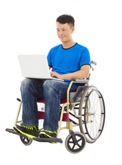 hopeful young man sitting on a wheelchair with a laptop