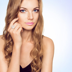 A beautiful young woman with a pink make up