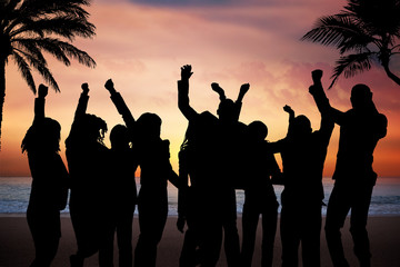 People Partying On Beach At Sunset