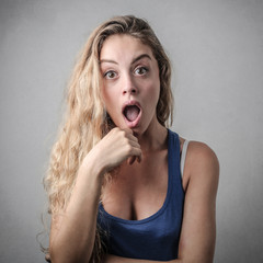 young woman looking surprised