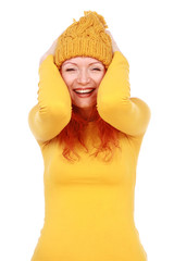 Portrait of young attractive emotional woman in yellow hat and b
