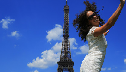 Poster - Beautiful girl jumping on the Eiffel tower