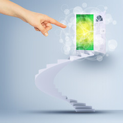 Finger pointing to spiral stairs