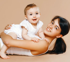 Lovely young mom and baby