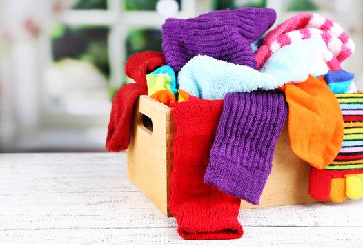 Multicoloured socks in a box