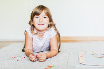Cute little girl playing in a room