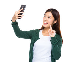 Young woman take selfie by cellphone