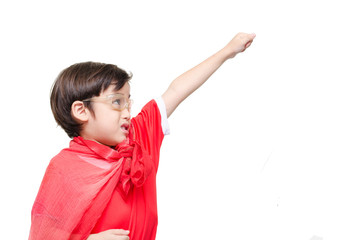 A young boy is dressed up as a superhero flying