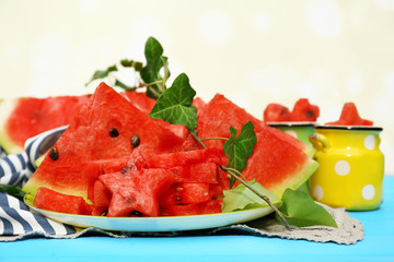 Fresh slices of watermelon on table, on bright background