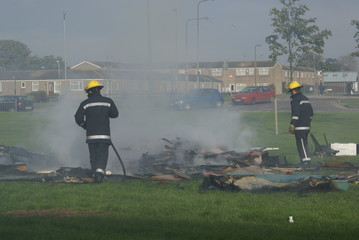 fire fighters at rubbish fire