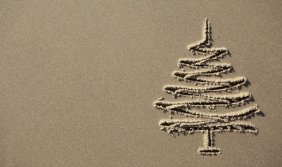 images christmas tree in the sand