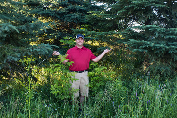 Golfer has lost his golf ball in the woods