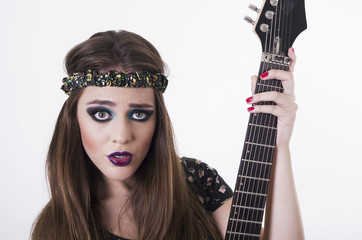 Beautiful rocker punk girl with colorful makeup holding electric