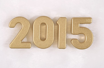 2015 year golden figures on a white
